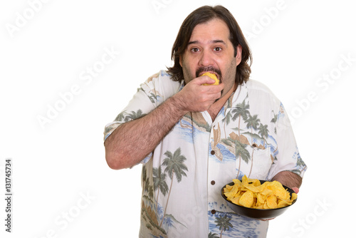 Fat Caucasian man eating mouthful of potato chips ready for vacation Poster