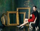 beauty rich brunette woman in luxury interior near empty frames, vintage elegance brunette