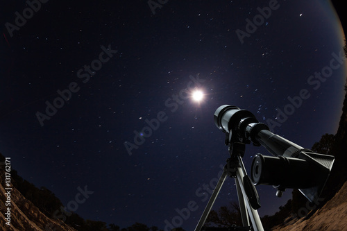 Telescope over night sky with stars and moon - 131762171