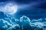 Fototapety Nighttime sky with clouds and bright full moon with shiny.