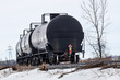Black Tank Cars Curving Around a Corner