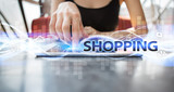 Woman using tablet pc and selecting shopping.