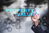 Businessman is drawing on virtual screen. property value concept.