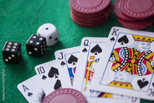 poker playcard dice on green table.Bet плакат