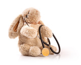 pediatrician concept - toy rabbit with stethoscope on white back