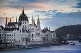 The Parliament Building in Budapest with dramatic sky at sunset