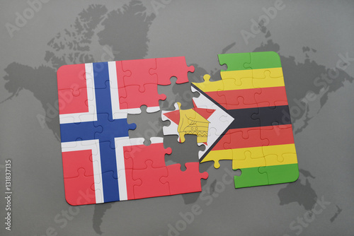 Poster puzzle with the national flag of norway and zimbabwe on a world map