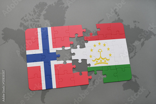 Poster puzzle with the national flag of norway and tajikistan on a world map