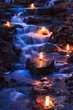 Waterfall with Multiple Candles at Twilight