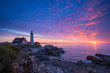 Vibrant sunrise at Portland Head Lighthouse in Maine