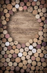 Wine corks over rustic wooden table