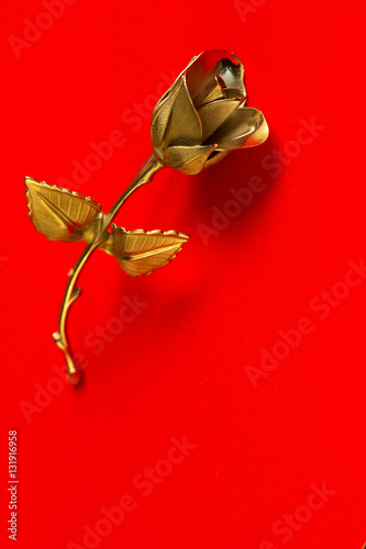 Poster one Metal rose on a red background for holiday greetings