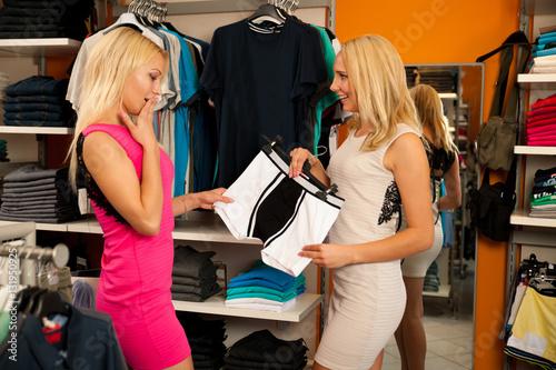 Poster Women in shopping for  man