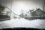 Winter Scene Through Car Window. Town Covered with Snow. Retro Picture.