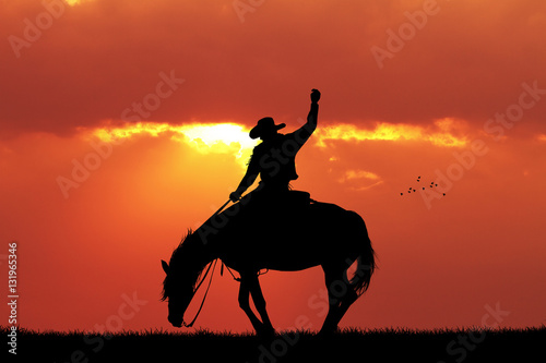 Foto op Canvas Baksteen cowboy rodeo silhouette at sunset