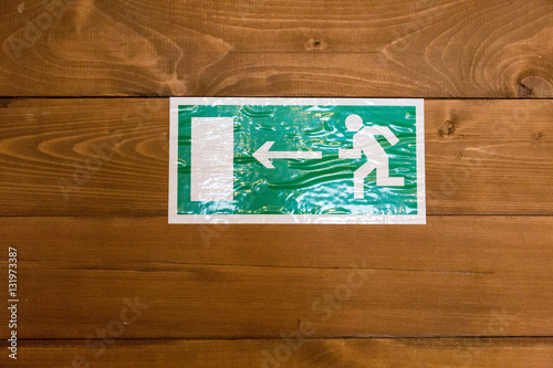 Poster Green and white label indicates the direction to the exit