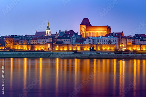 Fototapeta City of Torun in Poland, medieval Old Town skyline in the evening. Poland, Europe.