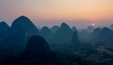 Foggy sunset. The view from the top of the Vine Mountains near Guilin - China