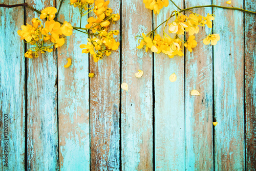 Yellow flowers on vintage wooden background, border design. vintage color tone - concept flower of spring or summer background - 132009703