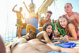 Happy friends taking selfie photo in boat party toasting beer