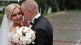 Bride and groom kiss, blocking umbrella