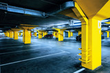 Underground garage parking lot with few cars and empty spaces - 132094963