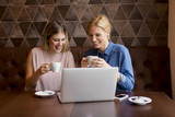 Young women with laptop in the cafe