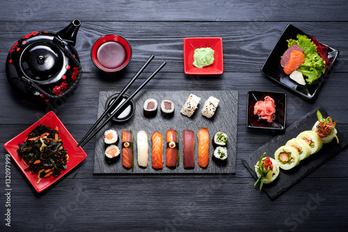 Staande foto Sushi bar Sushi set on black background top view