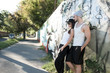 Young Couple leaning against a wall in a urban environment