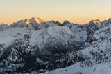 The sun illuminates the peaks.