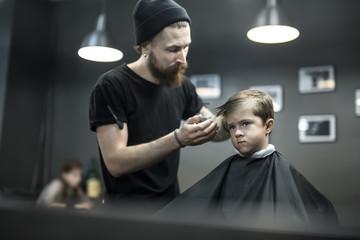 Kid's hair styling in barbershop