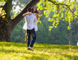 Young couple at the park.Beautiful day in nature.