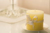 candle with a embroideret ribbon with natural light