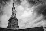 Lone figure looking at Statue of Liberty - 132169164