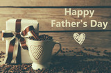 Fototapety Text HAPPY FATHER'S DAY on background. Gift on wooden table
