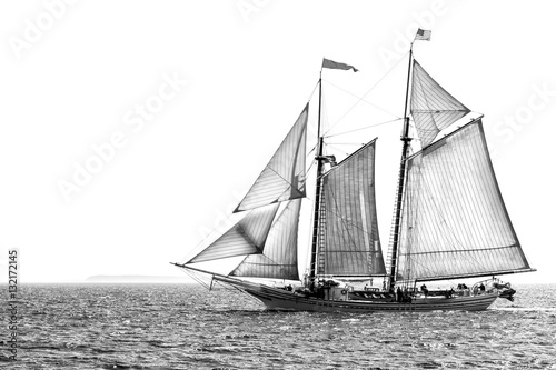 Fotobehang Zeilen Tall ship at sea black and white isolated with copy space