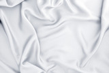 Close up wave white silk or satin fabric background