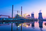 modern waterfront power plant at sunset