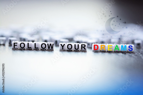 Poster Follow your dreams text made from plastic letter cubes