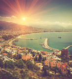View of Alanya bay:coastline, city, red tower, lighthouse. Mediterranean sea. Turkey.