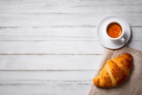cup of espresso coffee with croissant on white wooden table, empty space on left - 132223305