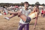 Man holding girlfriend during festival