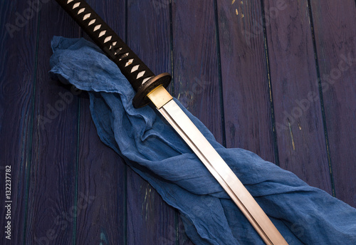 japan katana sword on the wood background with the blue shawl Poster