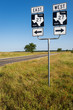 Road sign in a farm road in the Texas countryside in USA;  Concept for road trip in the USA