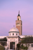 The minaret of La Marsa Mosque, Tunis the Tunisian capital in a colorful winter sunset. La Marsa is one of the most popular districts of Tunis province.