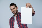Confident man holding a blank placard
