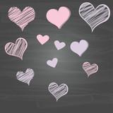 Scribble hearts on chalkboard