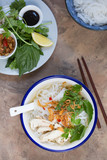 Pho ga- Vietnamese chicken noodle soup with crispy fried shallots and fresh herbs