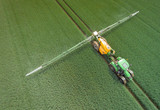 Aerial view of a tractor with field spray during use