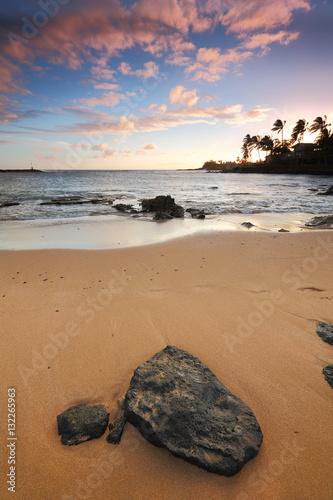 Foto op Canvas Zen Idyllic scene of a rock on a sandy beach